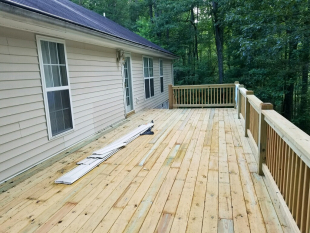 Deck rebuilt and enlarged by Gonzalez Landscaping and Home Improvement