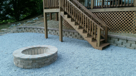 Brick paver fire pit and retaining wall by Gonzalez Landscaping and Home Improvement