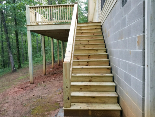 New stair case for rebuilt deck by Gonzalez Landscaping and Home Improvement.