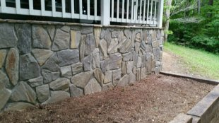 Rock veneer on exterior wall by Gonzalez Landscaping and Home Improvement