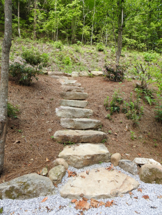 Close up of stone steps through landscaped hillside by Gonzalez Landscaping and Home Improvement